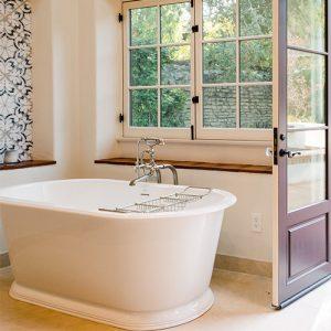 bathroom remodel with large porcelain tub