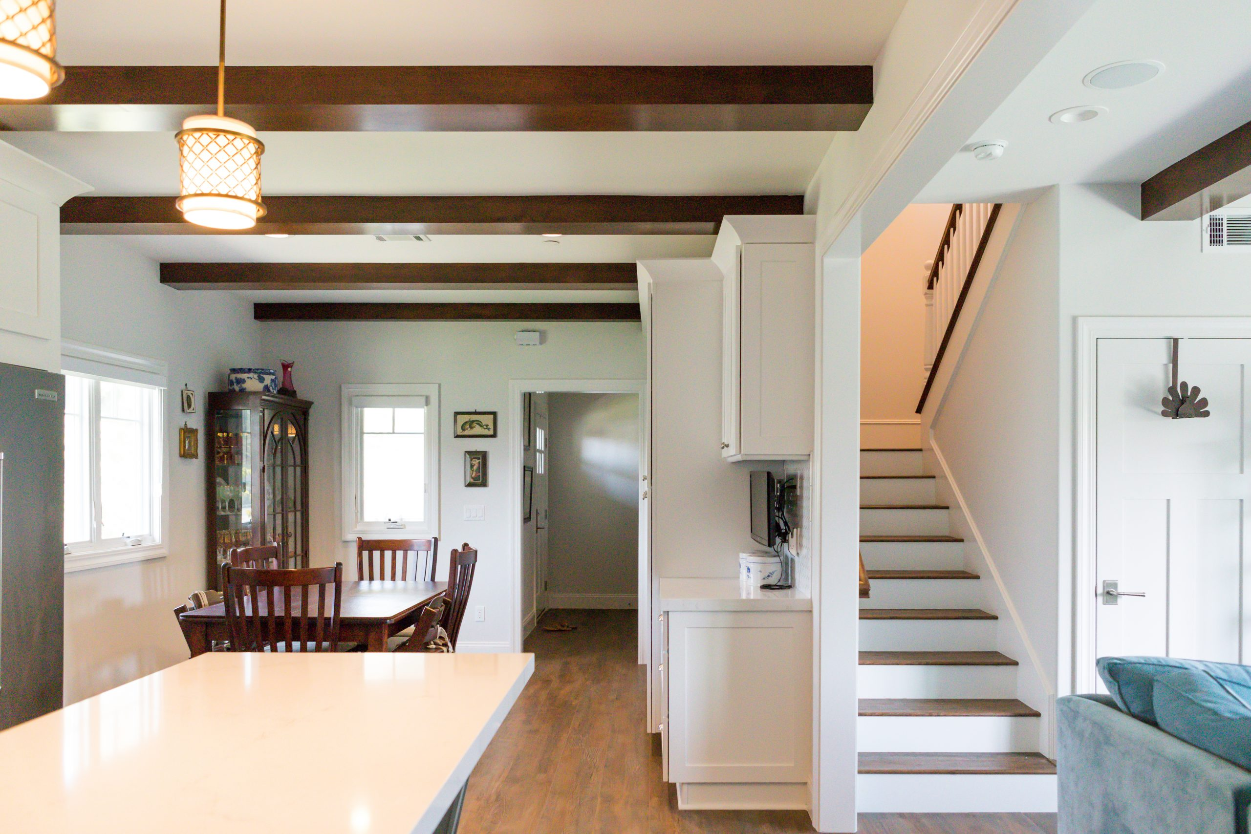 renovated room with original wood beam ceiling