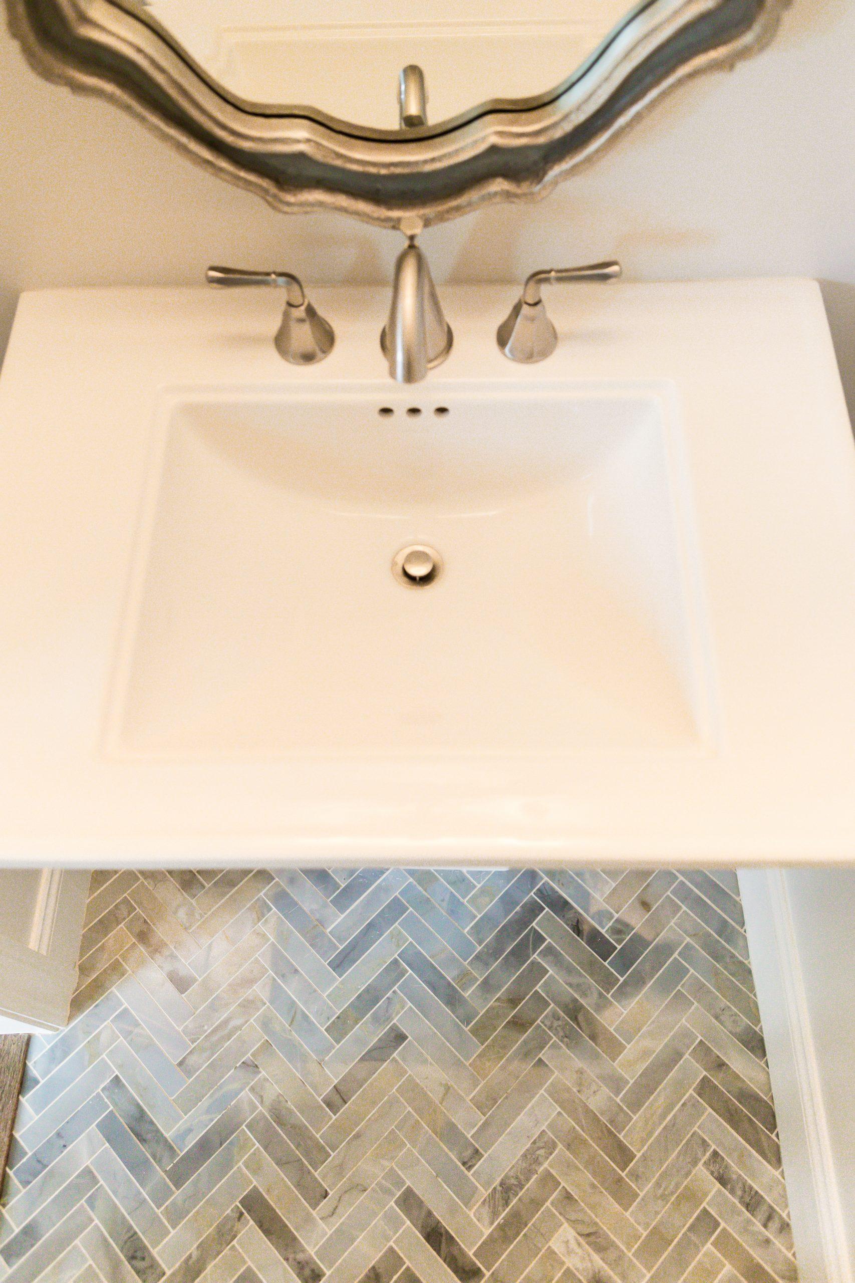 custom designed bathroom floor tile with modern sink