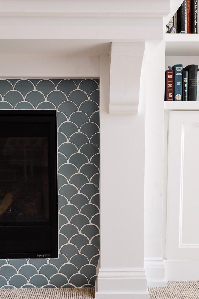 close-up of custom fireplace tile and bookshelf